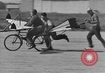 Image of Man attempts to fly a bicycle United States, 1921, second 15 stock footage video 65675044877