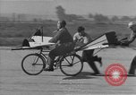 Image of Man attempts to fly a bicycle United States, 1921, second 16 stock footage video 65675044877