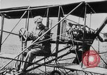 Image of Wright Flyer airplane Rheims France, 1909, second 2 stock footage video 65675044885