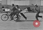 Image of testing a winged ornithopter bicycle United States USA, 1937, second 10 stock footage video 65675044894
