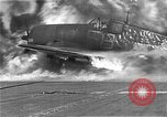 Image of Two F6Fs of VF-12 in flames on USS Randolph (CV-15) Pacific Ocean, 1945, second 8 stock footage video 65675044901