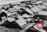 Image of typhoon Japan, 1953, second 2 stock footage video 65675045087