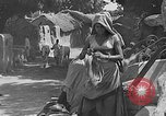 Image of scenes of Indian people at work, school and worship India, 1946, second 7 stock footage video 65675045102