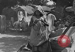 Image of scenes of Indian people at work, school and worship India, 1946, second 8 stock footage video 65675045102