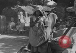 Image of scenes of Indian people at work, school and worship India, 1946, second 9 stock footage video 65675045102