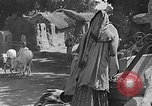 Image of scenes of Indian people at work, school and worship India, 1946, second 11 stock footage video 65675045102
