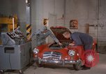 Image of repair a car Alaska USA, 1960, second 3 stock footage video 65675045185