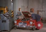 Image of repair a car Alaska USA, 1960, second 4 stock footage video 65675045185