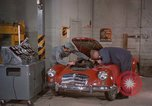Image of repair a car Alaska USA, 1960, second 7 stock footage video 65675045185