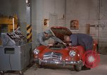 Image of repair a car Alaska USA, 1960, second 8 stock footage video 65675045185