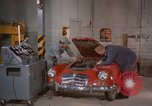 Image of repair a car Alaska USA, 1960, second 10 stock footage video 65675045185
