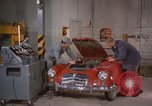 Image of repair a car Alaska USA, 1960, second 11 stock footage video 65675045185