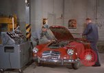 Image of repair a car Alaska USA, 1960, second 12 stock footage video 65675045185