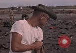 Image of clean up Vietnam, 1965, second 12 stock footage video 65675045230