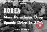 Image of mass parachute drop Korea, 1951, second 1 stock footage video 65675045385