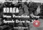 Image of mass parachute drop Korea, 1951, second 3 stock footage video 65675045385
