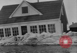 Image of flood Quebec Canada, 1951, second 11 stock footage video 65675045392