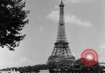 Image of Eiffel tower stunt Paris France, 1951, second 6 stock footage video 65675045402