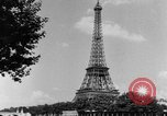 Image of Eiffel tower stunt Paris France, 1951, second 7 stock footage video 65675045402