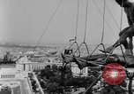 Image of Eiffel tower stunt Paris France, 1951, second 9 stock footage video 65675045402