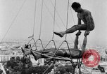 Image of Eiffel tower stunt Paris France, 1951, second 10 stock footage video 65675045402