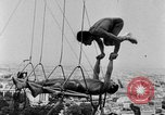 Image of Eiffel tower stunt Paris France, 1951, second 12 stock footage video 65675045402