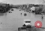Image of destruction by flood United States USA, 1952, second 8 stock footage video 65675045439
