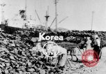 Image of battlefield salvage Korea, 1953, second 1 stock footage video 65675045457