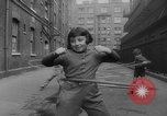 Image of hula hoops Germany, 1955, second 8 stock footage video 65675045477