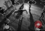 Image of hula hoops fad Poland, 1958, second 5 stock footage video 65675045482
