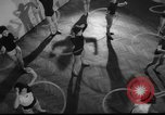 Image of hula hoops fad Poland, 1958, second 6 stock footage video 65675045482