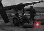Image of Mechanics performing maintenance on P-47s Chievres Belgium, 1944, second 5 stock footage video 65675045686