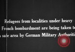 Image of German military assist refugees from areas of heavy French bombardment Western Front, 1915, second 2 stock footage video 65675045933