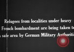Image of German military assist refugees from areas of heavy French bombardment Western Front, 1915, second 3 stock footage video 65675045933