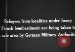 Image of German military assist refugees from areas of heavy French bombardment Western Front, 1915, second 5 stock footage video 65675045933
