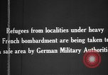 Image of German military assist refugees from areas of heavy French bombardment Western Front, 1915, second 6 stock footage video 65675045933