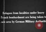 Image of German military assist refugees from areas of heavy French bombardment Western Front, 1915, second 7 stock footage video 65675045933