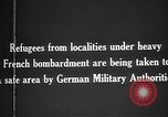 Image of German military assist refugees from areas of heavy French bombardment Western Front, 1915, second 9 stock footage video 65675045933