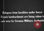 Image of German military assist refugees from areas of heavy French bombardment Western Front, 1915, second 10 stock footage video 65675045933