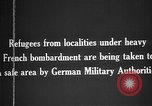 Image of German military assist refugees from areas of heavy French bombardment Western Front, 1915, second 12 stock footage video 65675045933