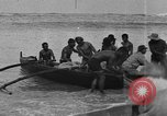 Image of Hawaiian people fishing and surfing Honolulu Hawaii USA, 1917, second 7 stock footage video 65675046043