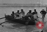 Image of Hawaiian people fishing and surfing Honolulu Hawaii USA, 1917, second 8 stock footage video 65675046043