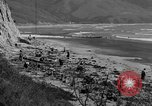 Image of Searching for ambergris on a beach Bolinas Beach California USA, 1934, second 2 stock footage video 65675046047