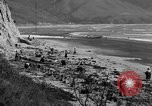 Image of Searching for ambergris on a beach Bolinas Beach California USA, 1934, second 5 stock footage video 65675046047