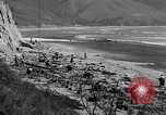 Image of Searching for ambergris on a beach Bolinas Beach California USA, 1934, second 6 stock footage video 65675046047