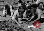 Image of Searching for ambergris on a beach Bolinas Beach California USA, 1934, second 8 stock footage video 65675046047