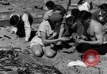 Image of Searching for ambergris on a beach Bolinas Beach California USA, 1934, second 11 stock footage video 65675046047