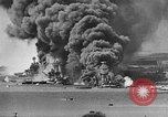 Image of Clouds of smoke from burning US warships Pearl Harbor Hawaii USA, 1942, second 3 stock footage video 65675046117