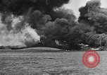 Image of Clouds of smoke from burning US warships Pearl Harbor Hawaii USA, 1942, second 4 stock footage video 65675046117