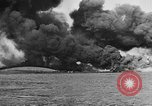 Image of Clouds of smoke from burning US warships Pearl Harbor Hawaii USA, 1942, second 6 stock footage video 65675046117